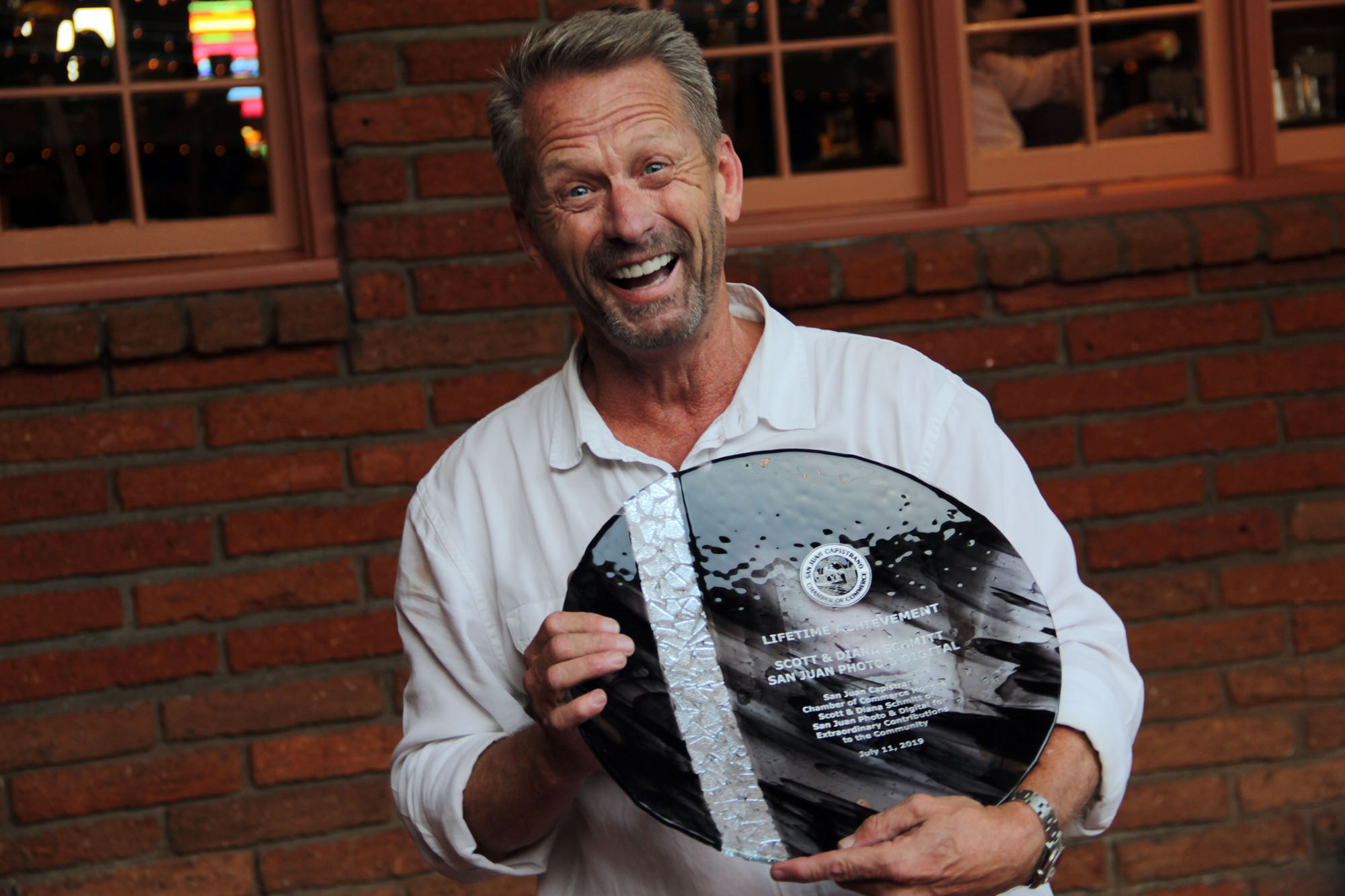 Scott Schmitt joyfully poses with the Lifetime Achievement Award he and his wife, Diana Schmitt, received during the Chamber of Commerce's Annual Installation and Awards Banquet on Thursday, July 11. Photo: Shawn Raymundo
