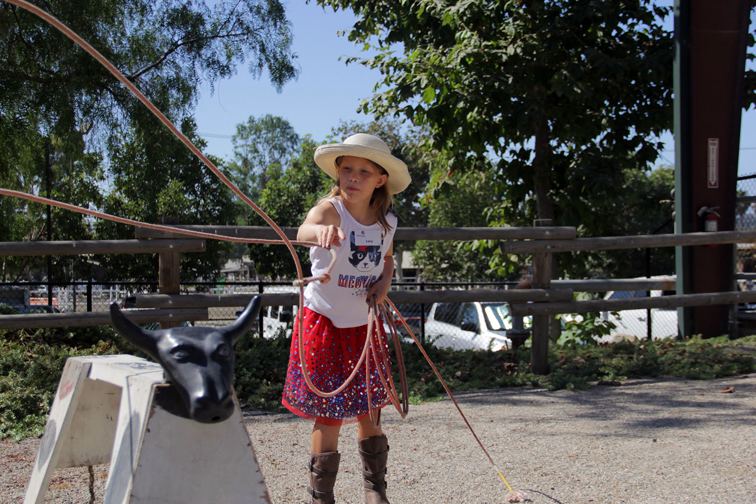 Lucy Kurtenacker releases her lasso as she tries to rope in the fake steer used to train children about rodeo-based skills at the J.F. Shea Therapeutic Riding Center's annual Cowboy Camp on Wednesday, Aug. 14. Photo: Shawn Raymundo