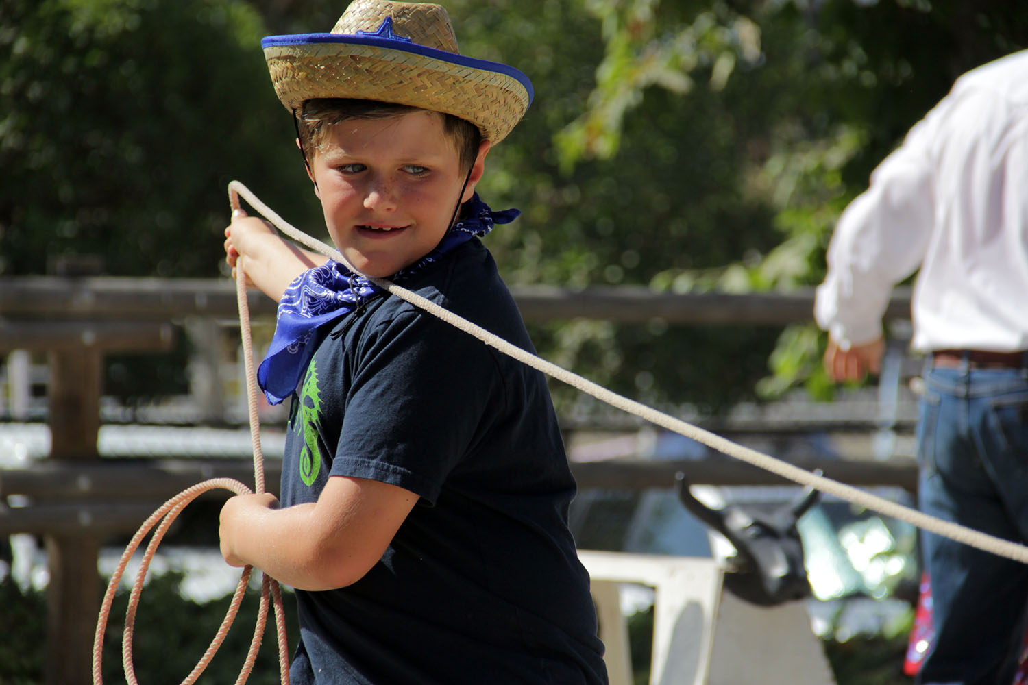 Johnny Coniglio pulls his rope tight after successfully getting the end of his lasso around a fake steer. Photo: Shawn Raymundo