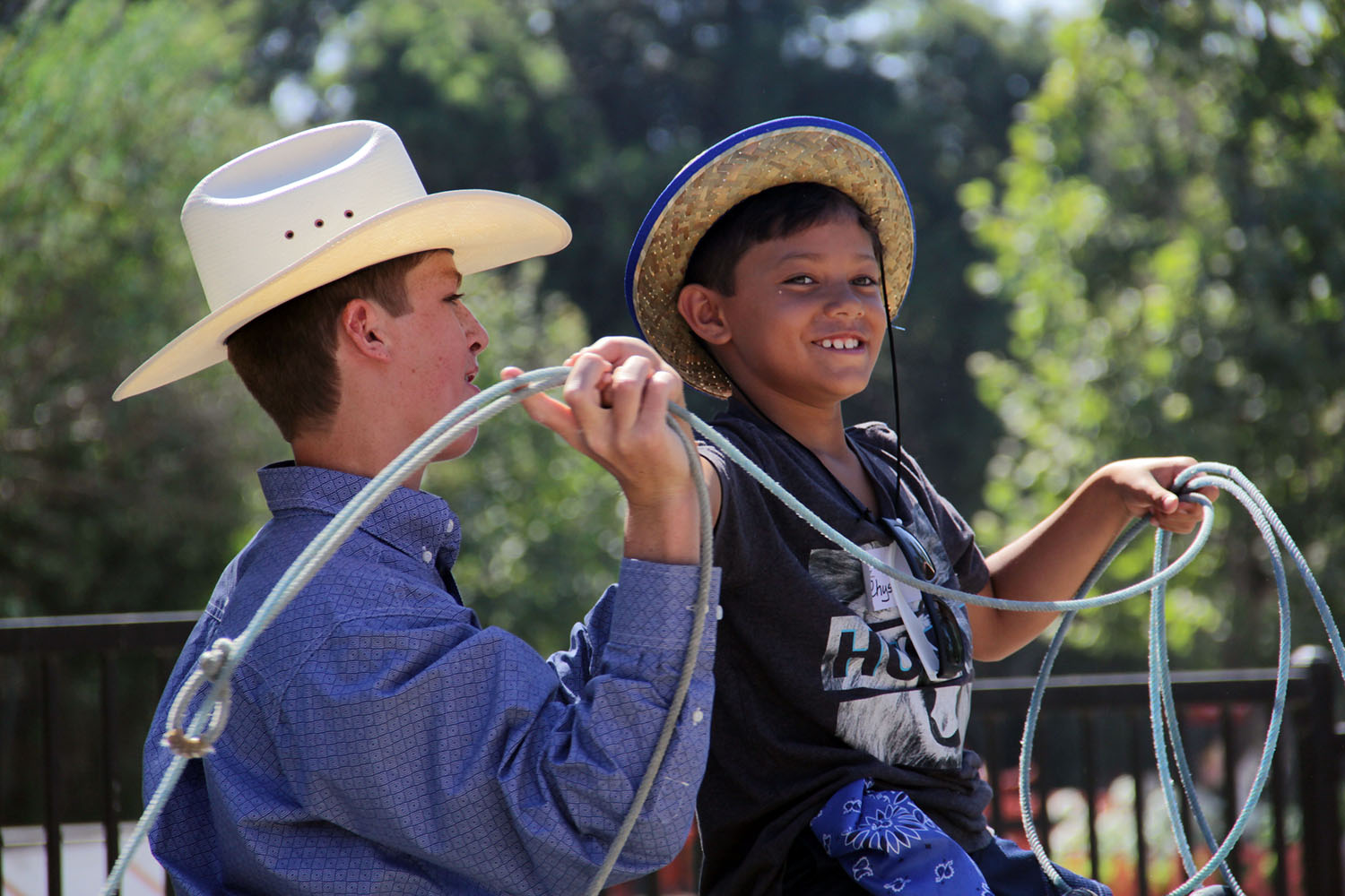 """Lance """"Deeg"""" Laster shows Rhys Taufaasau some lassoing techniques as part of the annual Cowboy Camp held at the J.F. Shea Therapeutic Riding Center on Wednesday, Aug. 14. Photo: Shawn Raymundo"""