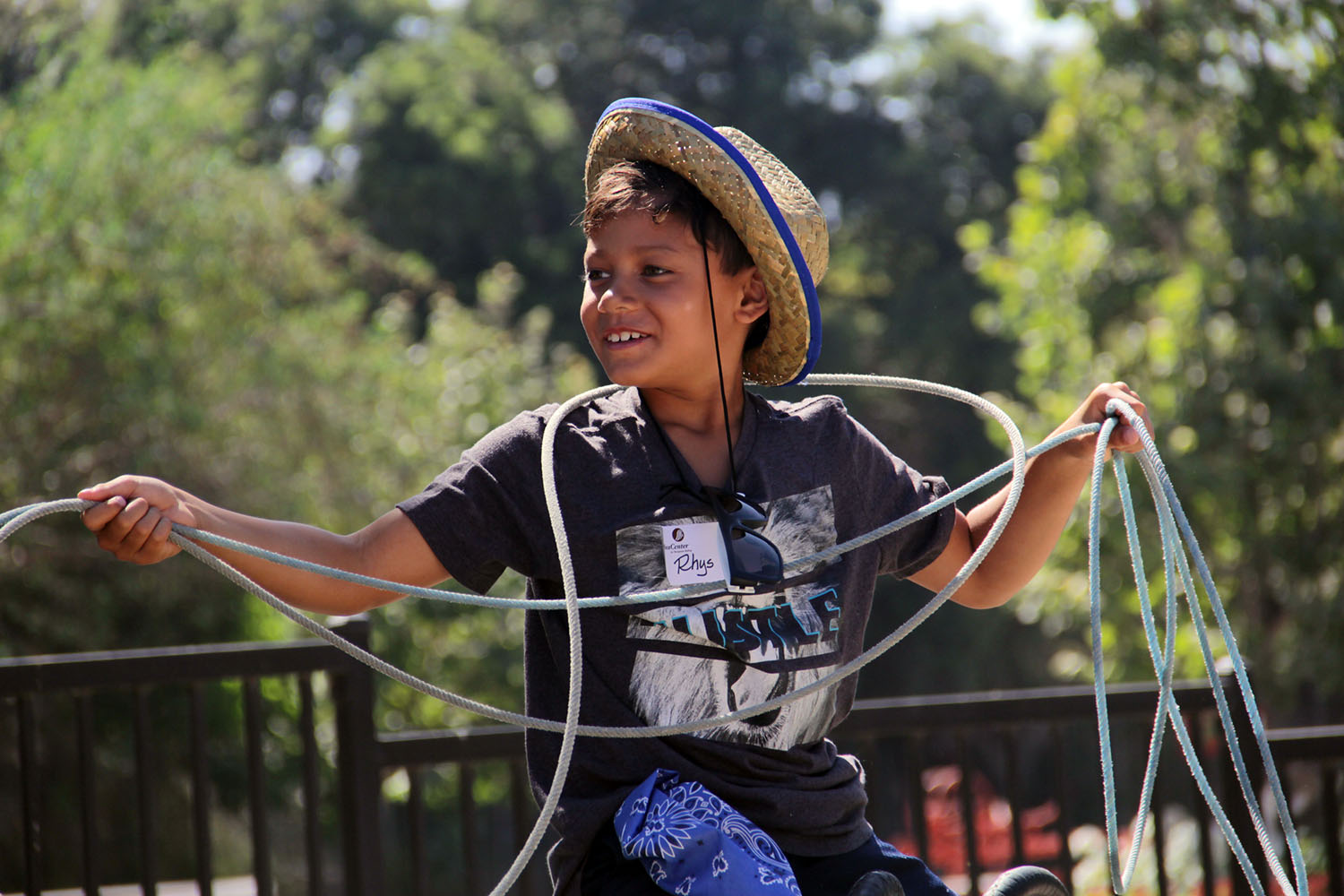 Rhys Taufaasau plays with the lasso during the J.F. Shea Therapeutic Riding Center's annual Cowboy Camp on Wednesday, Aug. 14. Photo: Shawn Raymundo