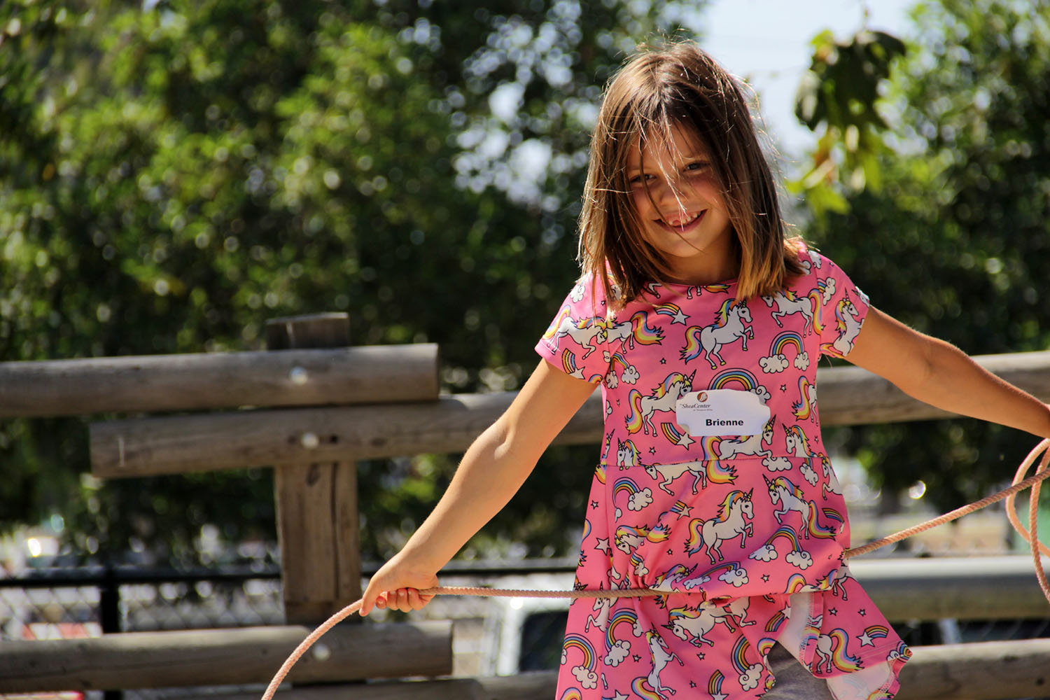 Brienne Grecho on Wednesday, Aug. 14, enjoys her time learning how to lasso at the J.F. Shea Therapeutic Riding Center, which holds its Cowboy Camp for kids ahead of this year's Rancho Mission Viejo Rodeo. Photo: Shawn Raymundo