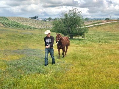 Taylor Santos and his young horse, Viejo, at home on the ranch. Photo: Courtesy of Taylor Santos